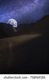 Valle de la Luna (Moon Valley) close to San Pedro de Atacama, Chile. starry sky shines at night.