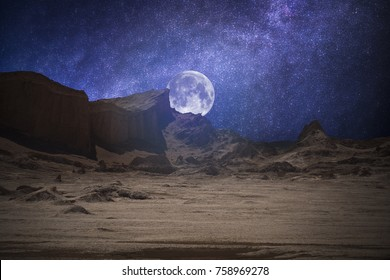 Valle de la Luna (Moon Valley) close to San Pedro de Atacama, Chile. starry sky shines at night.