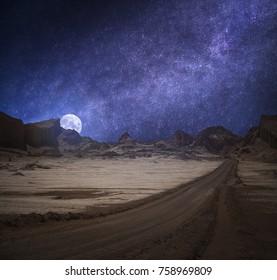 Valle de la Luna (Moon Valley) close to San Pedro de Atacama, Chiles. starry sky shines at night.