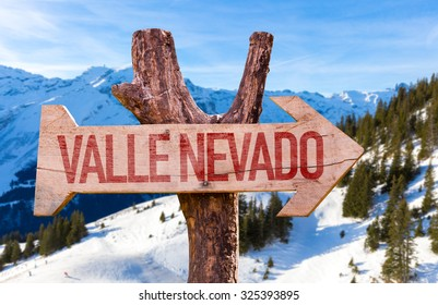 Valle Nevado wooden sign with winter background