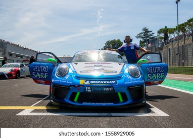 Vallelunga, Italy september 15 2019. Front low angle view of Porsche Carrera racing car in asphalt circuit starting grid before race start