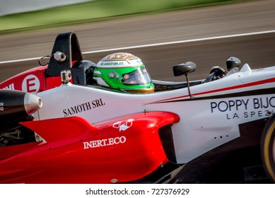 Vallelunga, Italy september 24 2017. Single seater formula driver in action closeup, red car and panning during the race, detail on helmet