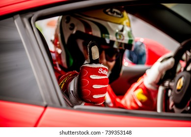 Vallelunga, Italy september 24 2017. Motorsport Ferrari touring car racing driver thumbs up close up in cockpit