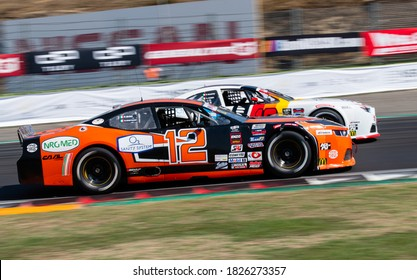 Vallelunga, Rome, Italy, 12 september 2020. American festival of Rome. Close up of cars challenging overtaking  during Nascar Euro championship race blurred background