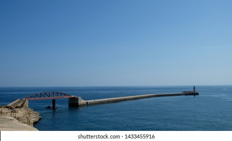 Valleta, capital city of Malta. On a sunny and very hot morning, view of St Elmo Bridge and it´s connection to St Elmo Lighthouse.