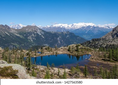 Valletta Lake and Monte Rosa, with Matterhorn, Mont Avic Park, between Champorcher Valley and Champdepraz Valley, Aosta Valley, Italy
