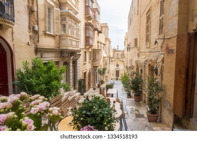 VALLETTA, MALTA - 1ST NOVEMBER 2018: St. Lucia's Street in Malta during the day. Showing typical architecture, balconies and the style of the streets.
