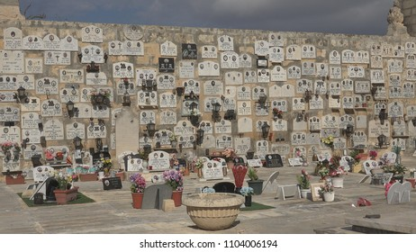 VALLETTA - MALTA, 2 OCTOBER, 2017,  Mdina catholic cemetery wall by day, churchyard memorial stone picture
