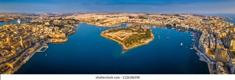 Valletta, Malta - Aerial panoramic skyline view of Valletta, Sliema, Manoel Island, Gzira, Ta' Xbiex, Msida and Floriana at sunrise
