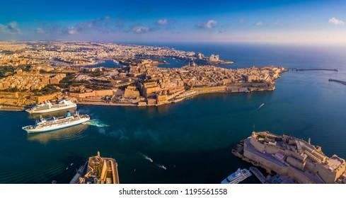 Valletta, Malta - Aerial panoramic skyline view of the Grand Harbour of Malta with cruise ships. This view includes Valletta, Floriana, Sliema, Manoel Island, Gzira, Birgu and Senglea from above