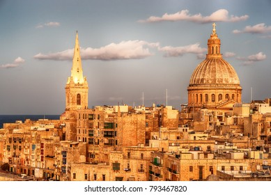 Valletta, Malta: aerial view from city walls at sunset. The cathedral