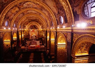 VALLETTA, MALTA - APR 10, 2018 - Baroque barrel vault with frescoes, Saint John Cathedral, Valletta, Malta