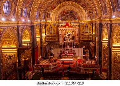VALLETTA, MALTA - APR 10, 2018 - Baroque barrel vault with frescoes and altar, Saint John Cathedral, Valletta, Malta