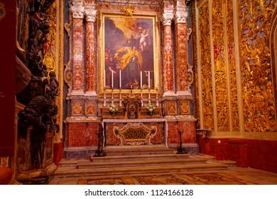 VALLETTA, MALTA - APR 10, 2018 - Baroque golden decorations on side chapel langue of Saint John Cathedral, Valletta, Malta