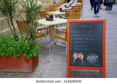 VALLETTA, MALTA - APR 10, 2018 - Menu board at outdoor restaurant in Valletta, Malta