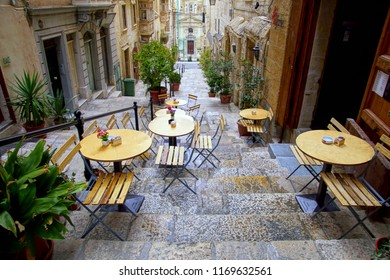 VALLETTA, MALTA - APR 10, 2018 - Outdoor restaurant table and chairs Valletta, Malta