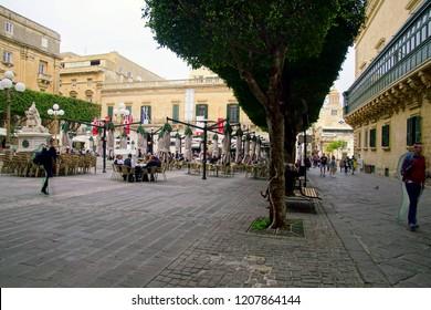 VALLETTA, MALTA - APR 10, 2018 - Small cafe with tables on  narrow street,Valletta, Malta