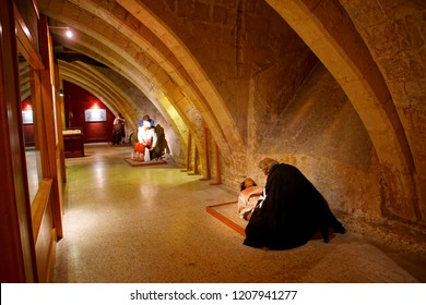 VALLETTA, MALTA - APR 10, 2018 - Dioramas with mannequins showing knights minstering in the hospital of Sacre Infirmia of Knights of St John Hospitaller, Valletta, Malta