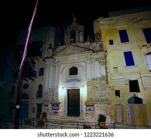 VALLETTA, MALTA - APR 10, 2018 - Nighttime illumination of parish chruch in Valletta, Malta