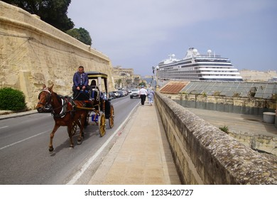 VALLETTA, MALTA - APR 10, 2018 - Horse and carriage with tourists in Valletta, Malta