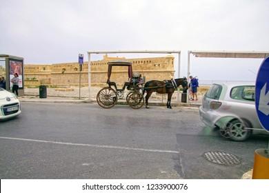 VALLETTA, MALTA - APR 10, 2018 - Horse and carriage await tourists in Valletta, Malta