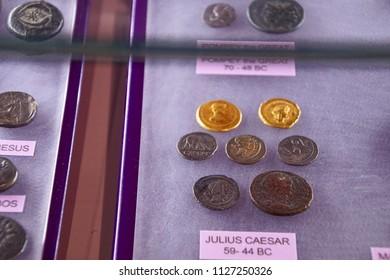 VALLETTA, MALTA - APR 11, 2018 - Roman coins of Julius Caesar and the Roman Republic, Archaeological Museum,Valletta, Malta