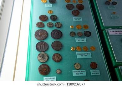 VALLETTA, MALTA - APR 11, 2018 - Gold and silver coins of the Byzantine Empire, Archaeological Museum,Valletta, Malta