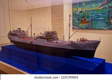 VALLETTA, MALTA - APR 11, 2018 - Model of USS Ohio tanker famous for 1942 convoy run in World War II siege, Malta Maritime Museum, Birgu Vittoriosa, Malta