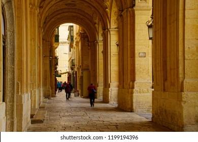 VALLETTA, MALTA - APR 11, 2018 - Limestone arcade of the National Library in Valletta, Malta