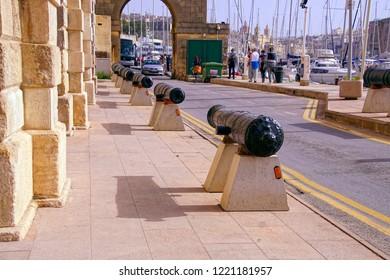 VALLETTA, MALTA - APR 11, 2018 - Naval cannon guarding the Malta Maritime Museum, Birgu Vittoriosa, Malta