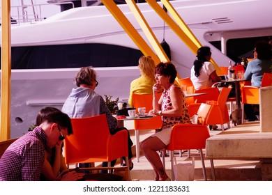 VALLETTA, MALTA - APR 11, 2018 - Tourists relax in a waterfront restaurant cafe in Birgu Vittoriosa, Malta