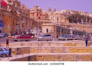 VALLETTA, MALTA - APR 11, 2018 - Traffic on the waterfront of  Valletta, Malta