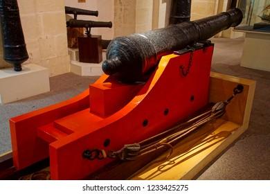VALLETTA, MALTA - APR 11, 2018 - Naval cannon ,Malta Maritime Museum, Birgu Vittoriosa, Malta