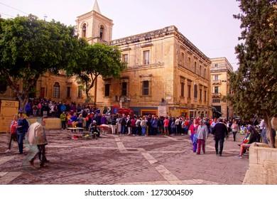 VALLETTA, MALTA - APR 11, 2018 - Crowd of passengers from cruise ships queue to enter the Saint John Cathedral, Valletta, Malta