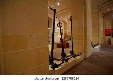 VALLETTA, MALTA - APR 11, 2018 - Ancient anchors in the Malta Maritime Museum, Birgu Vittoriosa, Malta