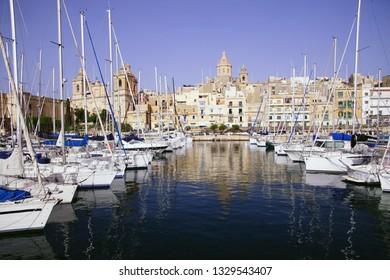 VALLETTA, MALTA - APR 11, 2018 - Yachts in marina on the Grand Harbor near the old city of Birgu Vittoriosa, Malta