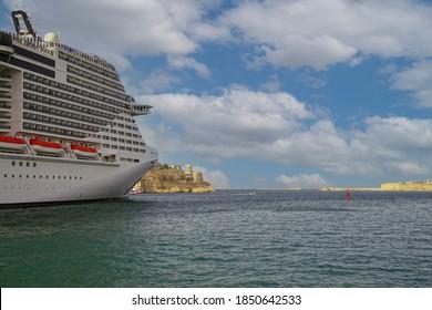 VALLETTA, MALTA - APR 11, 2018 - Huge cruise ship leaving the Grand Harbor of  Valletta, Malta