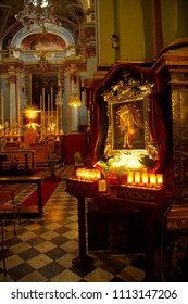 VALLETTA, MALTA - APR 12, 2018 - Small altar of the Virgin Mary with candles, Church of St Francis Assisi,  Valletta, Malta