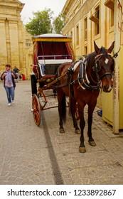 VALLETTA, MALTA - APR 12, 2018 - Horse and carriage await tourists in Valletta, Malta