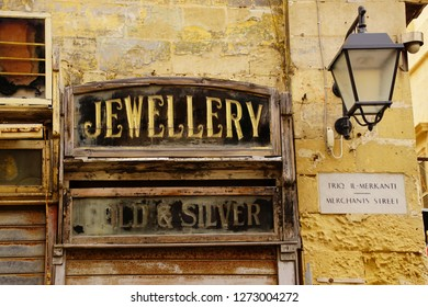 VALLETTA, MALTA - APR 12, 2018 - Vintage business signs on old buildings of Valletta, Malta