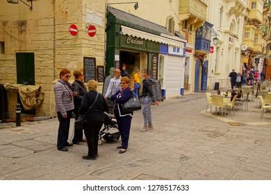 VALLETTA, MALTA - APR 12, 2018 - Sidewalk cafe on street of Valletta, Malta