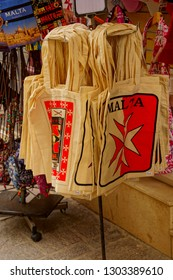VALLETTA, MALTA - APR 12, 2018 - Souvenir tote bags of Malta in a shop in Valletta, Malta