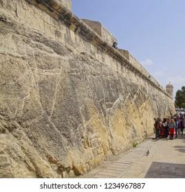 VALLETTA, MALTA - APR 19, 2018 - Young women plan their visit outside the city walls of Valletta, Malta