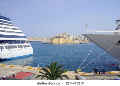 VALLETTA, MALTA - APR 19, 2018 - Cruise ships with Fort San Angelo in background in the Grand Harbor of Valletta, Malta