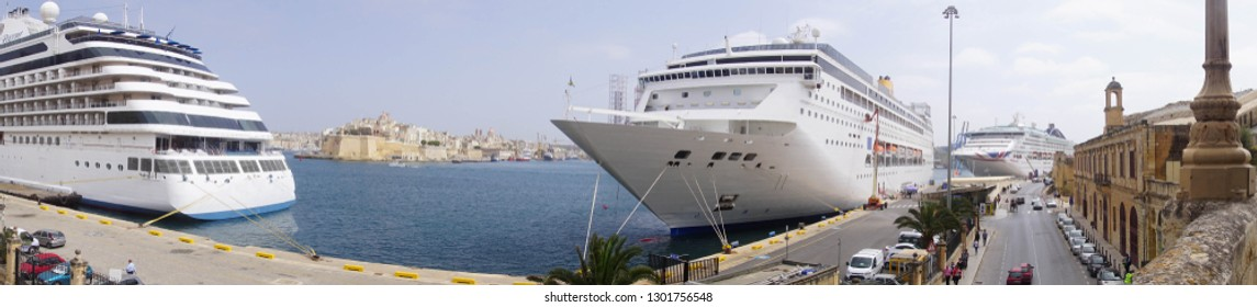 VALLETTA, MALTA - APR 19, 2018 - Panorama of cruise ships with Fort San Angelo in background in the Grand Harbor of Valletta, Malta