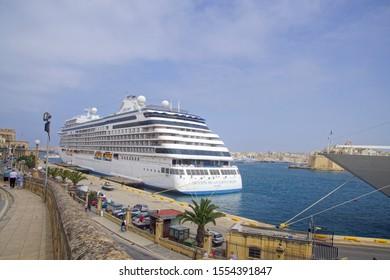 VALLETTA, MALTA - APR 19, 2018 - Cruise ships in the Grand Harbor with Fort San Angelo in background, Valletta, Malta