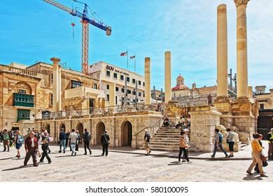 Valletta, Malta - April 3, 2014: People and Ruins of Royal Opera House in Valletta old town, Malta