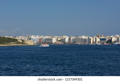 VALLETTA MALTA - aug 15, 2018: view of Sliema from Valletta side, Malta. Ferry coming from Sliema to Valleta. View to Sliema with blue sea and ferry in the background. Valletta, Malta, Europe