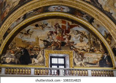 Valletta, Malta - August 04 2016: St John Roman Catholic Co-Cathedral interior art. Allegory of the Triumph of the Order of St John wall painting on lunette inside church built for Knights of St John.