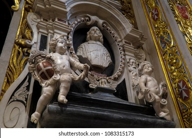 Valletta, Malta - August 04 2016: St John Roman Catholic Co-Cathedral interior art. Statue carvings which adorn stonewalls inside Baroque art and architecture church built for the Knights of St John.